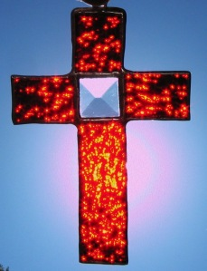 cross-red-with-bevel-bright-sun-behind