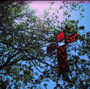 cross-red-with-bevel-with-tree-and-sun